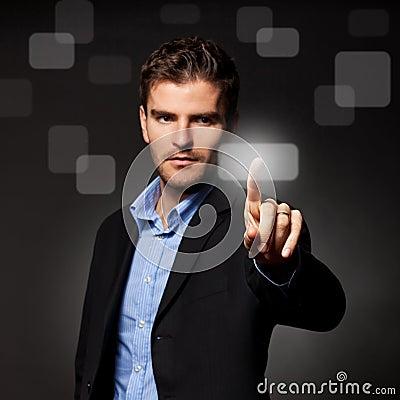 Business man pressing a touchscreen button