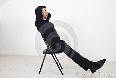 Business man resting on chair