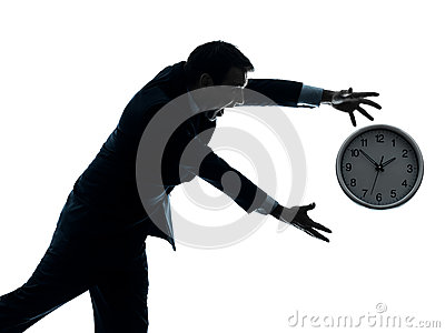 Business man running after clock silhouette