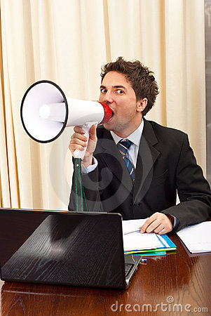 Business man shouting in megaphone