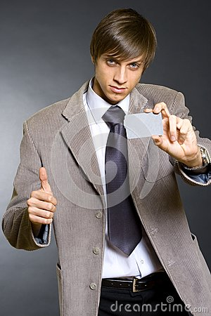 Business man showing a blank card