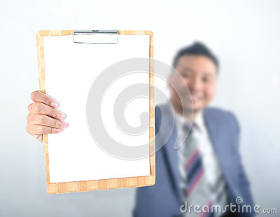 Business man showing note pad