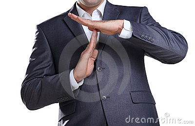 Business man showing time out sign