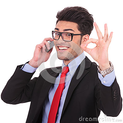 Business man shows ok sign on phone