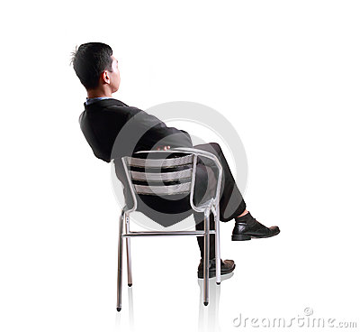 Business man sit down in single chair