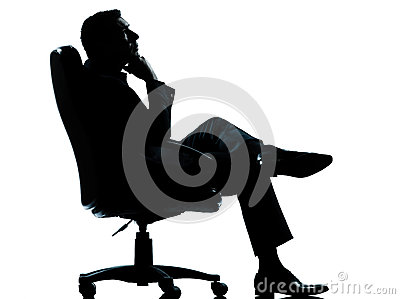 Business man sitting armchair relaxing silhouette