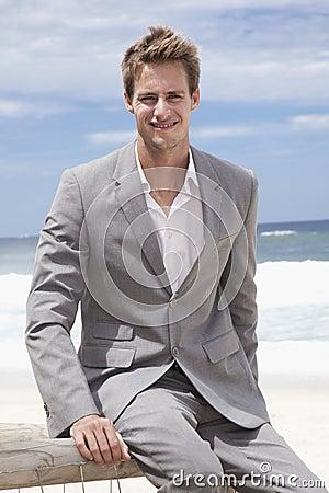 Business man sitting on the beach