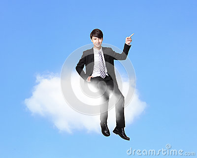 Business man sitting on a cloud