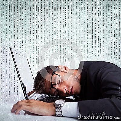 Business man sleeping on a laptop computer