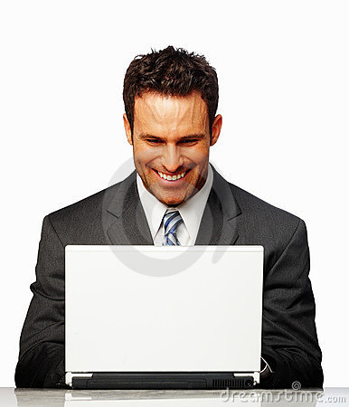 Business man smiling while working on laptop