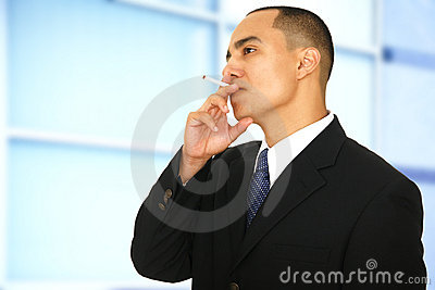Business Man Smoking In Office