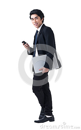 Business man standing with laptop and phone