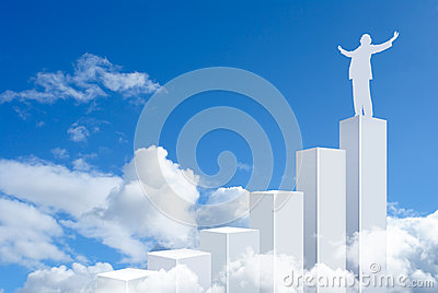Business man standing on top of a graph bars