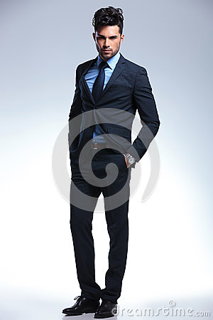 Free Business Man Stands Confident With Hands In Pockets Royalty Free Stock Images - 32079169