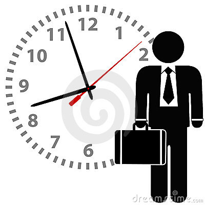 Business man stands in front of a time clock