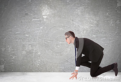 Business man at the start of a competition