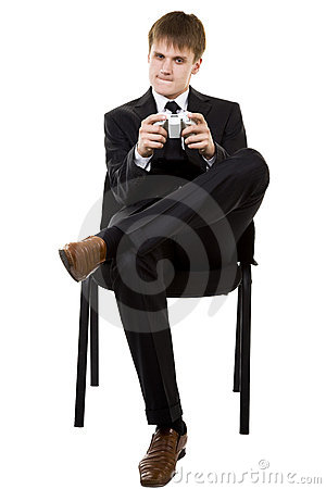 Business Man in suit playing console games