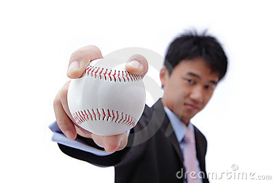 Business man take baseball with confident smile