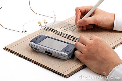 Business man taking meeting notes with cell phones and glasses