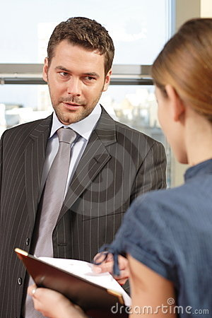 Business man talking to his secretary in the office
