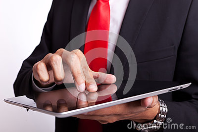 Business man tapping and browsing on pad