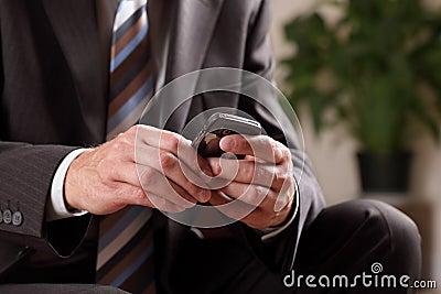 Business man text messaging