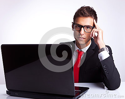 Business man thinking at desk