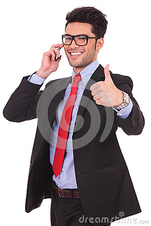Business man thumbs up at the phone