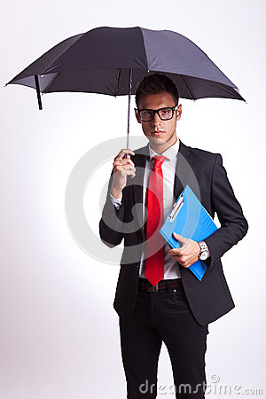 Business man with umbrella and notepad