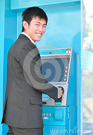 Business man using ATM