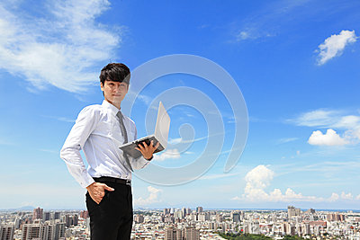Business man using laptop and look to you