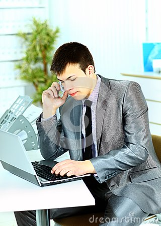business man using laptop in modern office