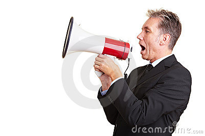 Business man using a megaphone