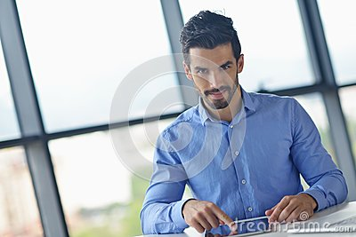 Business man using tablet compuer at office