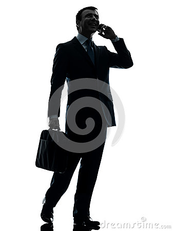 Business man walking on the telephone silhouette