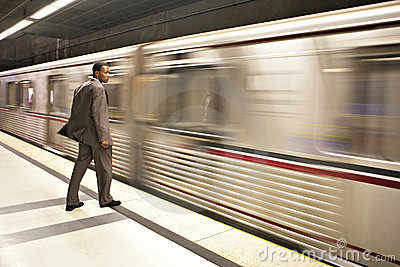Business Man Watching the Subway Pass By