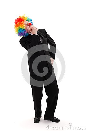 Business man wearing colorful clown wig