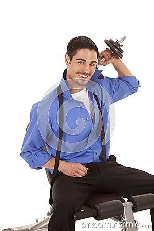 Business man weights over shoulder smile