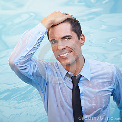 Business man with wet clothing in water