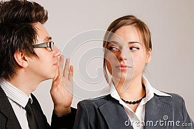 Business man whispering to partner