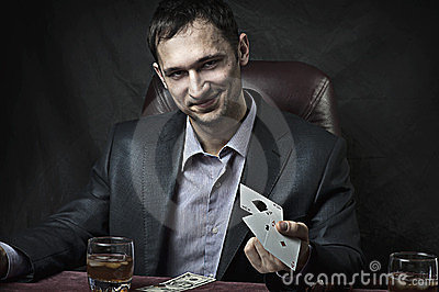 Business man winner playing poker