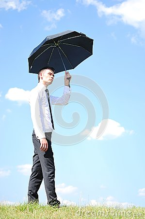 Free Business Man With Umbrella Royalty Free Stock Photo - 25800725