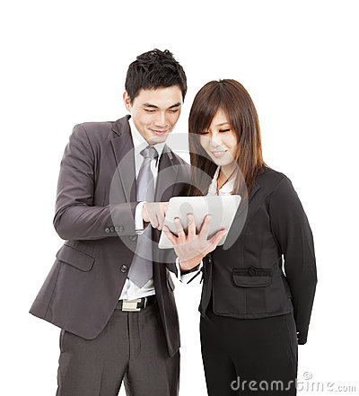 Business man and woman using the tablet pc