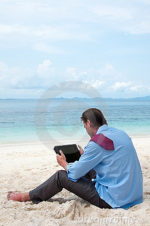 Business man working on the beach with pc