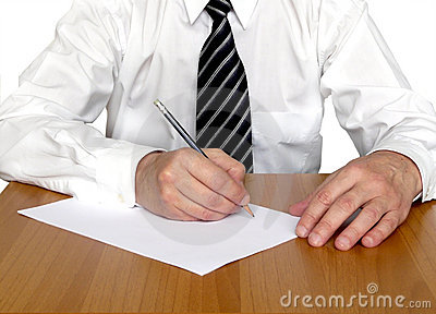 Business man writing at table