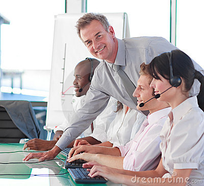 Business manager in a call centre Stock Photo