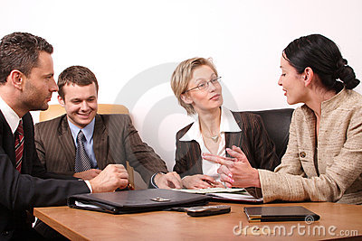 Business meeting of 4 persons