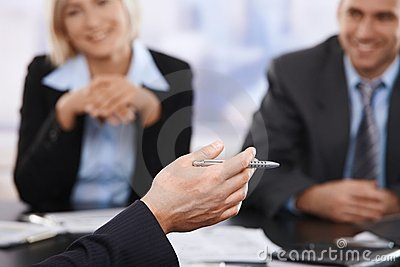 Business meeting, hand with pen in closeup