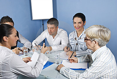 Business meeting with working people