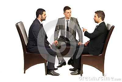 Business men on chairs having conversation